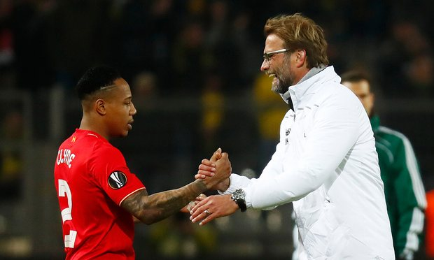 Klopp talking to Nathaniel Cyne during the action in Germany
